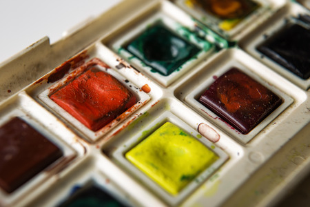 paintbox: old well used artist watercolour paints set Stock Photo