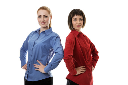 woman standing back: two business woman standing back to back