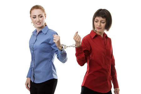 two business woman handcuffed together Stock Photo