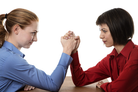 wrestling: Two business women arm wrestling each other