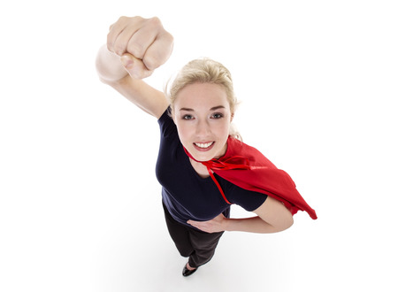 powerful: woman wearing a super hero cape shot from above looking down Stock Photo