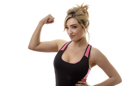 flexing: fitness woman flexing muscles showing you how strong she is Stock Photo