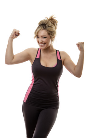 strong women: fitness woman flexing muscles showing you how strong she is Stock Photo
