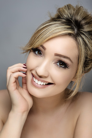 headshot: beauty headshot of young woman shot in the studio Stock Photo
