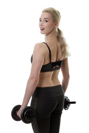levantando pesas: fitness mujer levantando pesas Foto de archivo