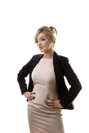 hands on hips: business woman standing with her hands on her hips Stock Photo