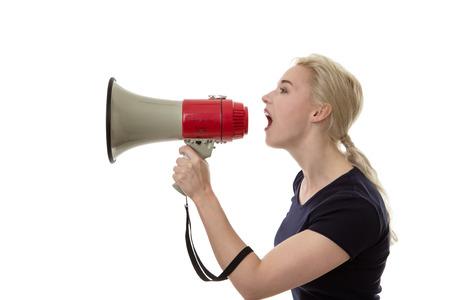 loud speaker: woman shouting down a loud speaker Stock Photo