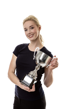 award trophy: standing happy business woman holding a large trophy