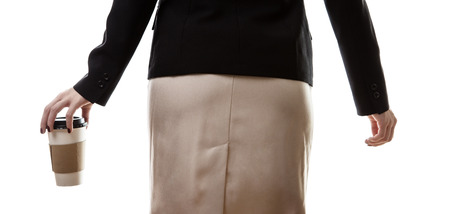 bum: close up shot of a businesswomans bum in one hand she is holding a paper coffee cup Stock Photo