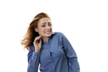 windswept: business woman with windswept hair blowing from the side Stock Photo