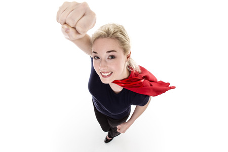 powerful creativity: woman wearing a super hero cape shot from above looking down Stock Photo