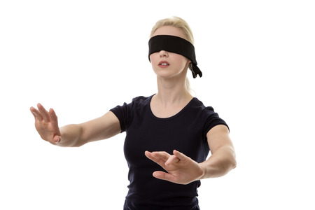 blindfold: woman wearing a blindfold not sure what to do