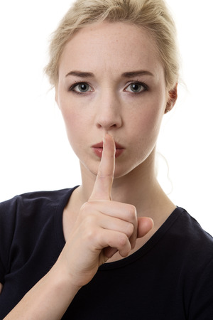 woman with finger to her lips letting you know she expect quiet from you