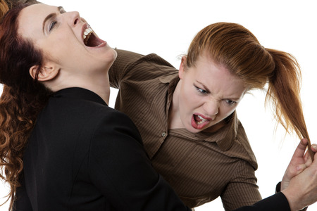 two business woman fighting each other at work Stock Photo