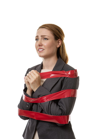 Business woman caught up in red tape
