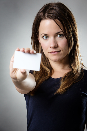 businesscard: business woman showing you a businesscard