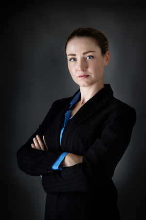low key lighting: portrait of a business woman done in the studio with low key lighting