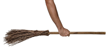 broomstick: Old wicked witches broomstick being held in clenched right hand