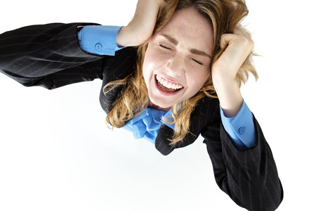 tearing down: Frustrated pretty brunette woman with hands on her head, tearing her hair out in frustration