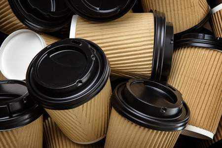 lids: Pile of disposable take away coffee tea cups with black lids