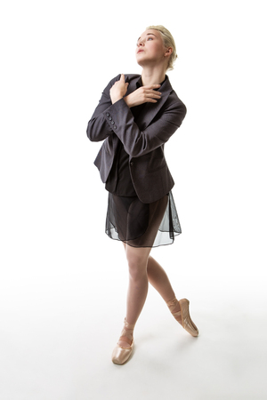 poised: Ballerina poised ready to dance whilst wearing a suit jacket