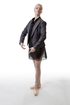 poised: Dancer poised ready to begin dancing wearing a suit jacket and a tutu Stock Photo