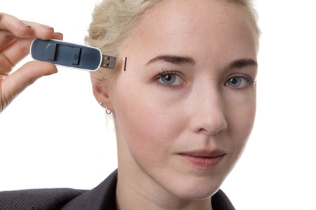 memory stick: Woman holding a USB memory stick putting it in the side of her head