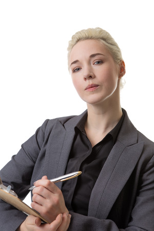 poised: Business woman with her pen poised ready to write