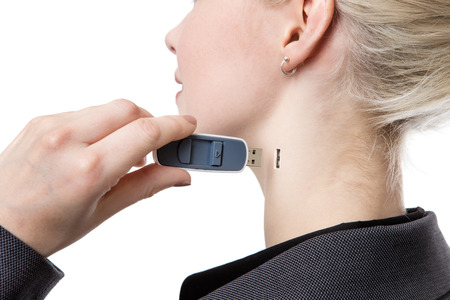 memory stick: shot from behind of a woman holding a memory stick putting it into the side of her neck