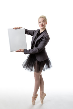 ballet dance: Model in a suit jacket and tutu, holding a blank board ready to display a sign