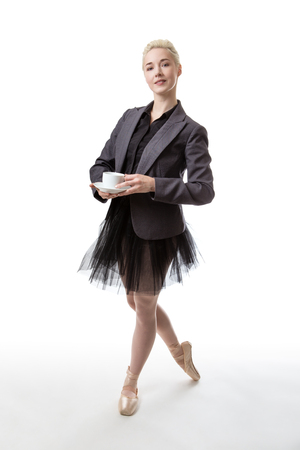 hot secretary: Happy woman in a business suit having a cup of tea or coffee