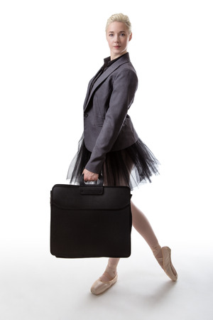 brief case: Woman in a business suit jacket and a tutu, carrying a brief case