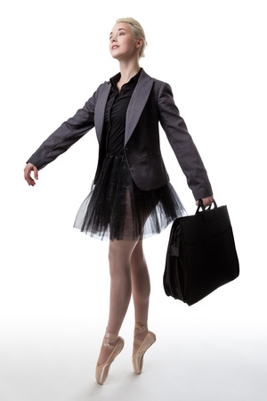 brief: Woman in a business suit jacket and a tutu, carrying a brief case