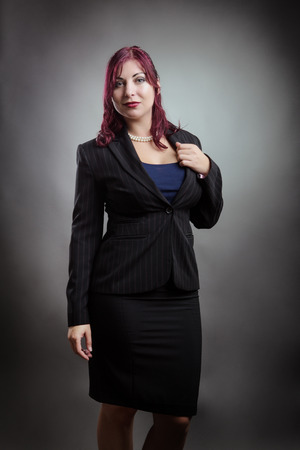 smartly: Studio shot of a smartly dressed woman in a business suit