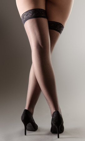 hold ups: sexy women with long legs wearing hold ups and high heels shoes