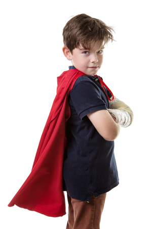 lad: young lad in a red cape is unable to fly with his broken arm
