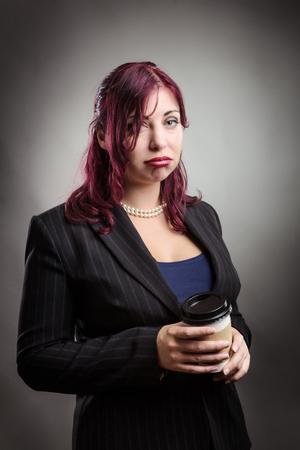 grumpy: business woman is looking grumpy with a takeaway coffeetea