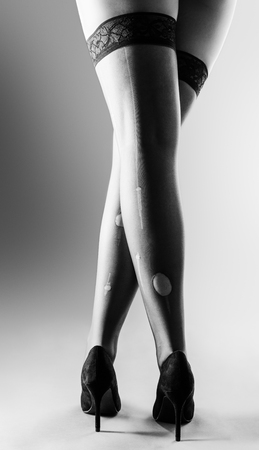 kinky: sexy women with long legs wearing hold ups all laddered and high heels shoes Stock Photo