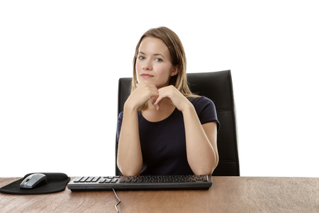 at her desk: businesswoman at her desk looking