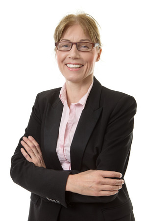 middle adult: Close up shot of a smart office worker in a suit jacket, wearing glasses with her arms folded,  isolated on white. Stock Photo