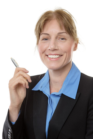 pleased: Close up shot of a business woman, smiling and looking pleased, holding a pen, isolated on white.