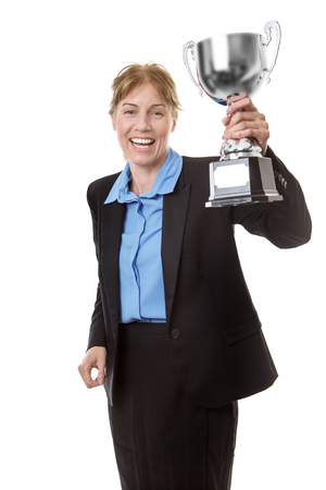 shiny suit: Business woman  wearing a suit with a blue shirt, is clutching hold of a trophy to celebrate her win! Stock Photo