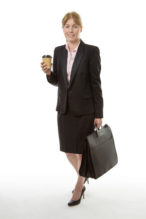 brief case: Full length shot of a smart business woman, holding a take away drink on one hand and a brief case in the other, isolated on white.