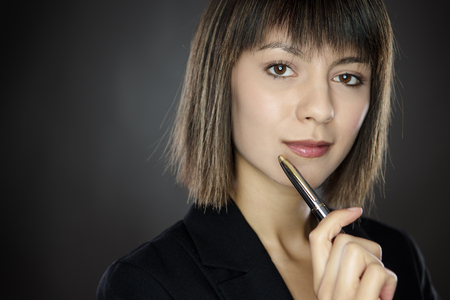 introspective: close up portrait shot of young successful business woman looking pensive. Stock Photo