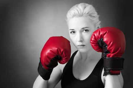 low key lighting: woman wearing boxing gloves shot in the studio low key lighting Stock Photo