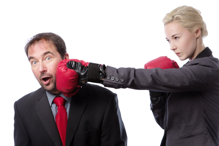vindictive: A businessman receiving punch to the side of his head from his co-worker isolated on white background