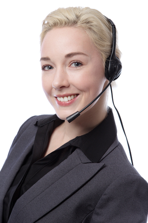 smartly: Close up portrait of a smartly dressed business woman wearing a black blouse and a suit jacket, wearing a headset.  Isolated on white.