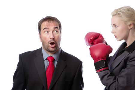 vengeance: Upper body shot of two co-workers getting ready for a fight, one wearing boxing gloves.  isolated on white