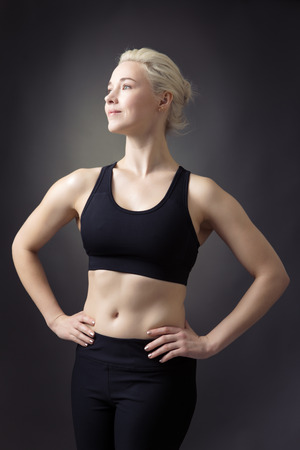 low key lighting: strong looking fitness woman low key lighting shot in the studio Stock Photo