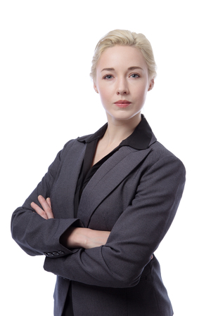smartly: Close up portrait of a smartly dressed business woman wearing a black blouse and a suit jacket.  Isolated on white. Stock Photo